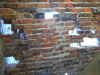 Gift shop wall after deteriorated bricks removed.